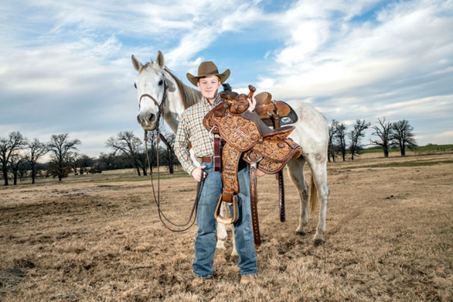 Ty Woods, 15, of Decatur won the Junior NFR team roping championship in Las Vegas last week after being paired with 10-year-old heeler Michael Calmelat of Arizona.